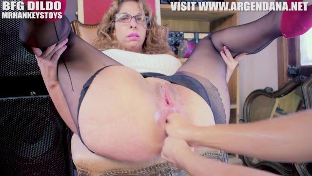 Sexy Milf fucks her ass with huge dildo