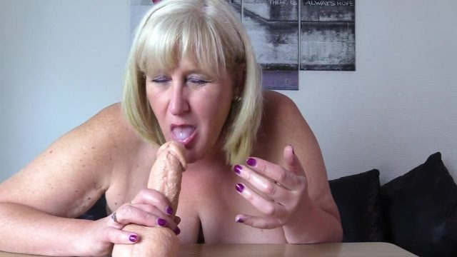 Cock sucking StepMom practices her oral skills on Thick Cum Spurting Dildo