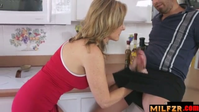 Mother gives handjob in kitchen